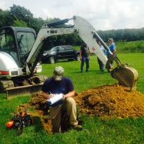 Nathan evaluating a soil probe.